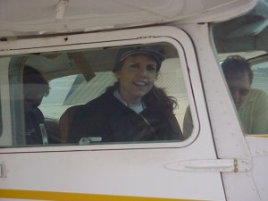 Computer teacher Mrs. Cole and her husband Dave wait while pilot Nevens prepares for takeoff.