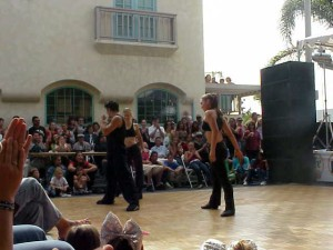 The crowd watches dancers at the Avocado Festival.