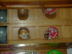 Two of the many football helmets displayed at The Zone. The one on the right was worn by The Zone's owner when he was in school.